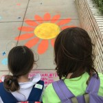 Anne and Evy check out the clssafewalk art outside school!